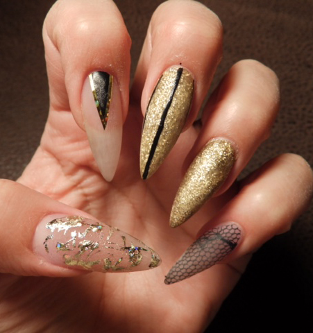 Nail art tutorial nail design nail art how to stiletto bling nails step 2 once dry line the outside of the triangle using gold striping tape now using ibd clear gel coat entire nail covering the art you just drew all prinsesfo Gallery