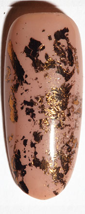 Apply gold foil to random parts of your nail. | Second Skin: 3 Snake Skin Nail Art Tutorials; check them out at http://www.nailpro.com/snake-skin-nail-art-tutorials