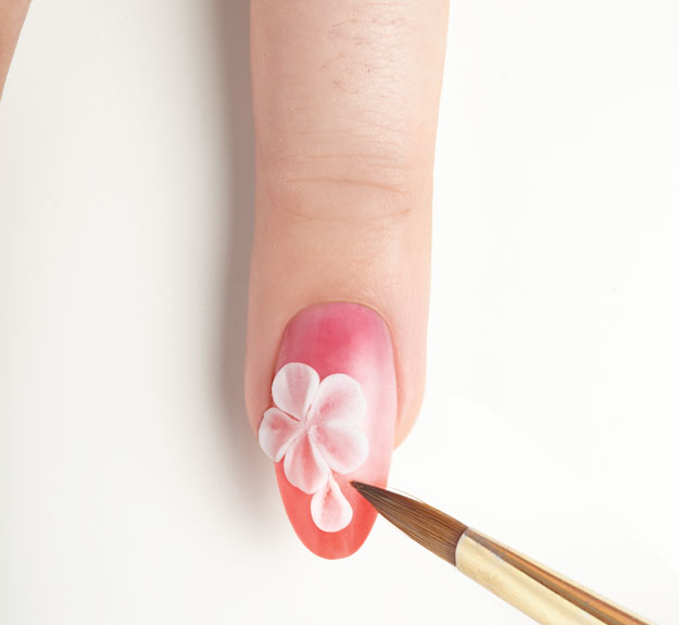 Follow steps 2-5 to create your first petal. | Nail Art Tutorial: How to Create a 3-D Acrylic Flower; see the step-by-step tutorial at http://www.nailpro.com/3d-flower