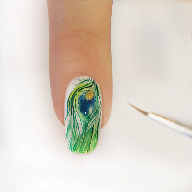 Add a gold teardrop to the nail design. | How to do Aquarelle Nail Art, the Newest Nail Art Trend; check out the how-to at http://www.nailpro.com/aquarelle