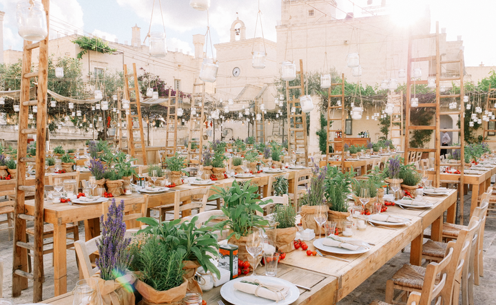 """""""Puglia is a region in Southern Italy [that] has this epic, ancient aura that provides the most stunning backdrop for a wedding. We designed tablescapes with the agrarian bounty Puglia provides—from wild vegetables and herbs to olive branches. It was an amazing event under the Italian sun that was a sensory and visual delight."""""""