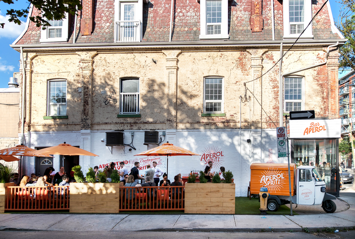 Bar Aperol is open at 1030 Queen Street West throughout July. The pop-up bar serves Aperol Spritz cocktails, an Italian aperitivo food menu by the Cheese Boutique, and coffee by Lavazza.