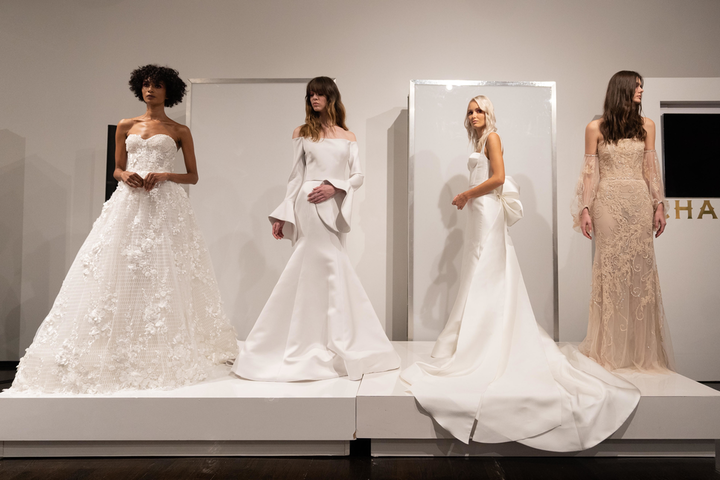 Celebrated Canadian bridal gown designer Rita Vinieris (whose fall 2019 collection is pictured here) has launched a campaign to raise money and sew facial masks to help protect healthcare workers in Canada and the U.S.